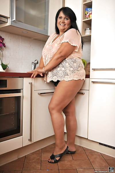 BBW brunette Bubi poses and..