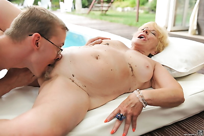 Horny old Malya naked by the..