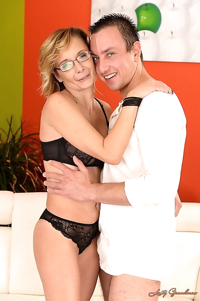 Mature blonde with glasses..