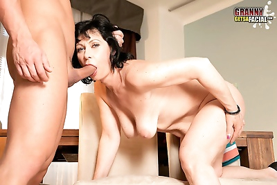 Brunette grandmother seduces..