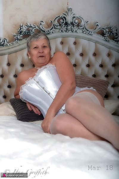 Granny first timer Savana hides her naked body after removing lingerie on bed