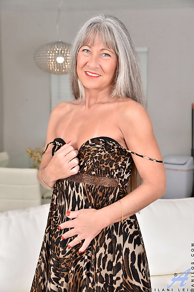 Grey haired granny Leilani Lei shows her tiny tits with tan lines & her twat
