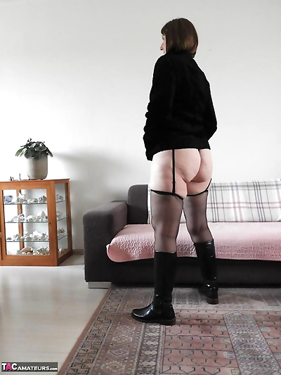 Old woman in leather boots..