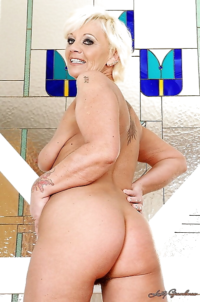 Horny granny stripping off..