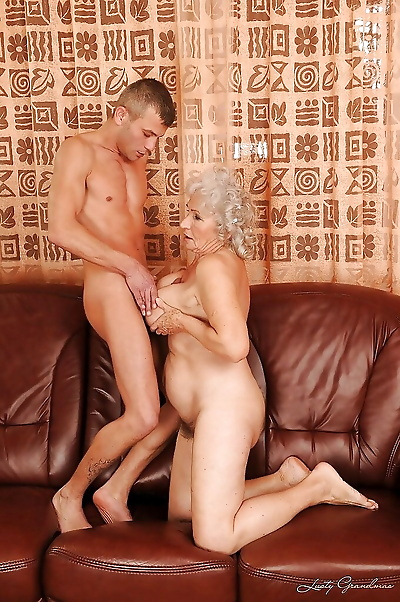 Busty granny gets a meaty..