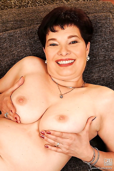 Busty brunette granny with..