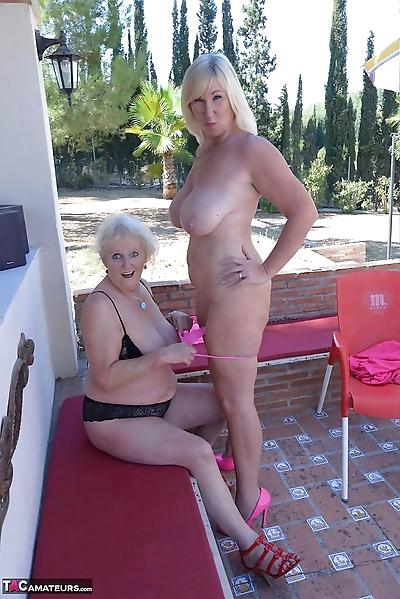 Older lesbian strips her..