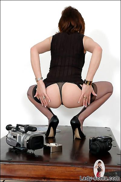 Seamed black stockings leggy..