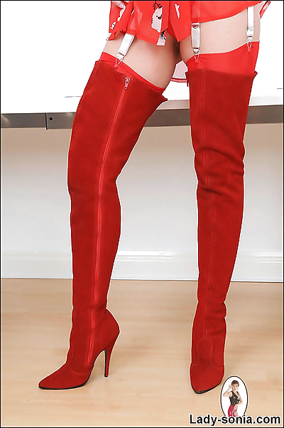 Red suede thigh boots..