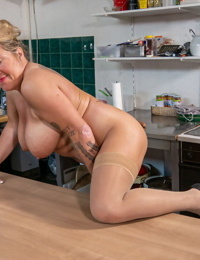 Old cleaning woman strips to sheer stockings while masturbating in the kitchen