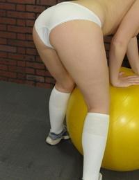 Innocent teen Brooke Adams shows her medium tits and big ass in locker room